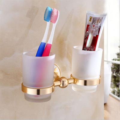 Jednoduchý dvojitý stojan s pohárikmi na zubné kefky v zlatej farbe