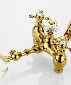 Prepracovaná vaňová batéria a sprcha v zlatej farbe s keramickým dekorom